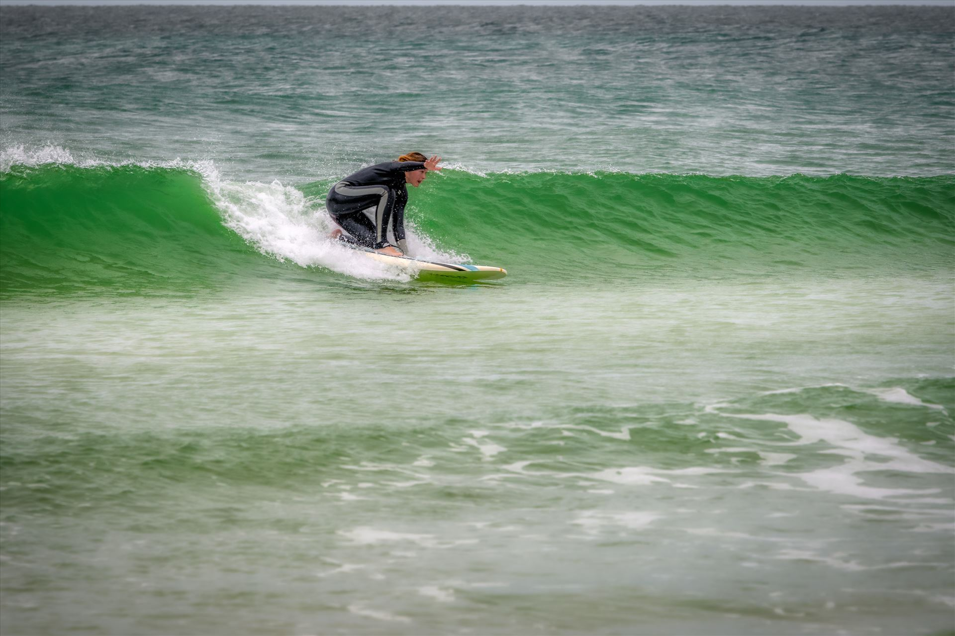 surfer girl - Female surfer at St. Andrews State Park at the jetties by Terry Kelly Photography