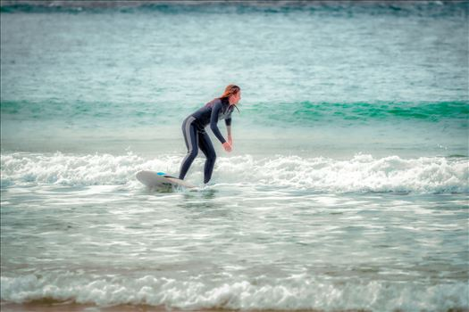 Female surfer at St. Andrews State Park at the jetties.