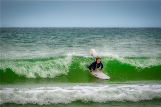 Female surfer at St. Andrews State Park at the jetties